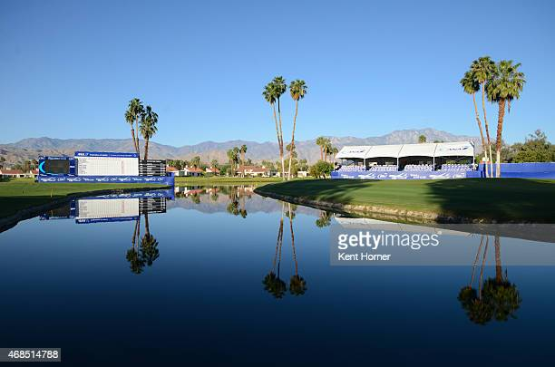 The leaderboard is reflected onto the water of Poppy's Pond near the 18th green of the ANA Inspiration prior to the start of Round Two at Mission...
