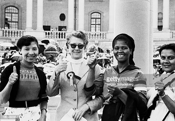 The leaders of the Federation of South African Women give the thumbs up after delivering a petition to the Union Buildings in Pretoria South Africa...