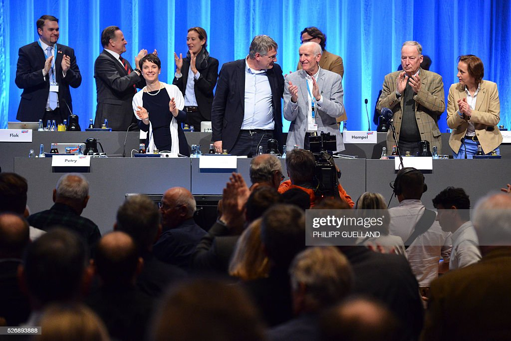 The leadership of the german right wing party Alternative for Germany (AfD) applaus at the end of their party congress at the Stuttgart Congress Centre ICS on May 1, 2016 in Stuttgart, southern Germany. Germany's right-wing populist AfD adopted an anti-Islam policy in a manifesto that also demands curbs to immigration, as a poll showed it is now the country's third strongest party. / AFP / Philipp GUELLAND