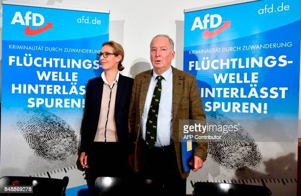 The leading candidates of the antiimmigration and Islamophobic party AfD Alexander Gauland and Alice Weidel pose ahead of a press conference about...