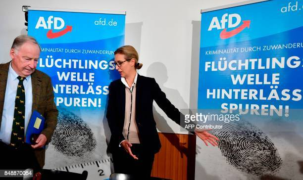 The leading candidates of the antiimmigration and Islamophobic party AfD Alexander Gauland and Alice Weidel arrive ahead of a press conference about...
