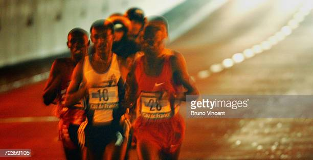 The leading group of runners are seen passing through a road tunnel during the Paris Marathon on April 4 in Paris