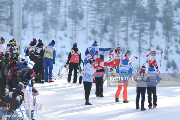 The leading group with Marit Bjoergen and heidi Weng arrives at the feeding zone during Ladies crosscountry 30 km Mass Start Free final at FIS Nordic...