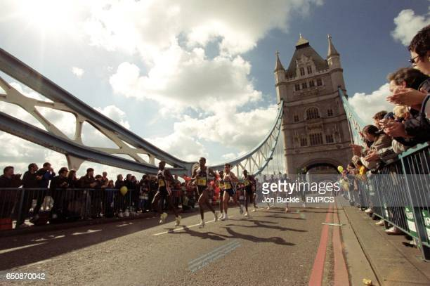 The leading pack cross Tower Bridge