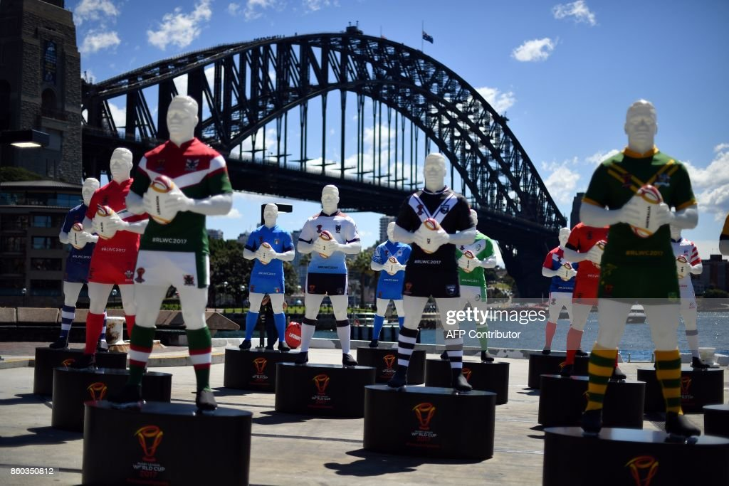 The League of Giants installation is seen in front of the Sydney Harbour Bridge on October 12, 2017. The installation of 14 giant rugby league players represents the 2017 Rugby League World Cup participating nations and will be exhibited in four host cities from October 16 to December 2. / AFP PHOTO / Saeed KHAN