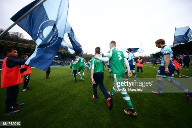The Leatherhead team walk out prior to The Emirates FA Cup Second Round between Wycombe Wanderers and Leatherhead at Adams Park on December 3 2017 in...