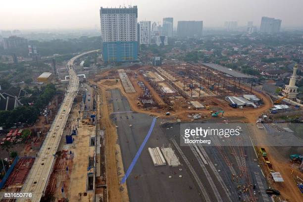 The Lebak Bulus station for the Jakarta Mass Rapid Transit stands under construction in this aerial photograph taken in Jakarta Indonesia on Sunday...