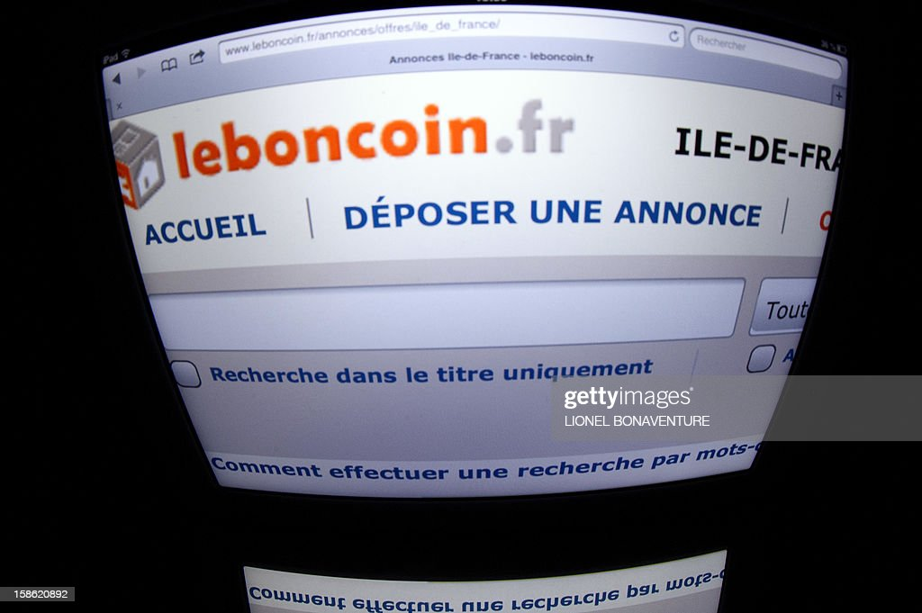 The Leboncoin logo is displayed on a tablet on December 21, 2012 in Paris.