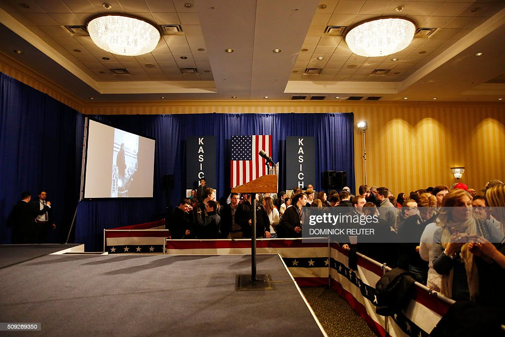 The lectern is seen as supporters of Ohio Governor and Republican presidential candidate John Kasich wait for results during a primary election watch party, February 9, 2016, in Concord, New Hampshire. Political novice Donald Trump won New Hampshire's presidential primaries, US media projected, with a fierce battle for second place among Ohio Governor John Kasich, former Florida governor Jeb Bush, Senators Ted Cruz and Marco Rubio. / AFP / DOMINICK REUTER