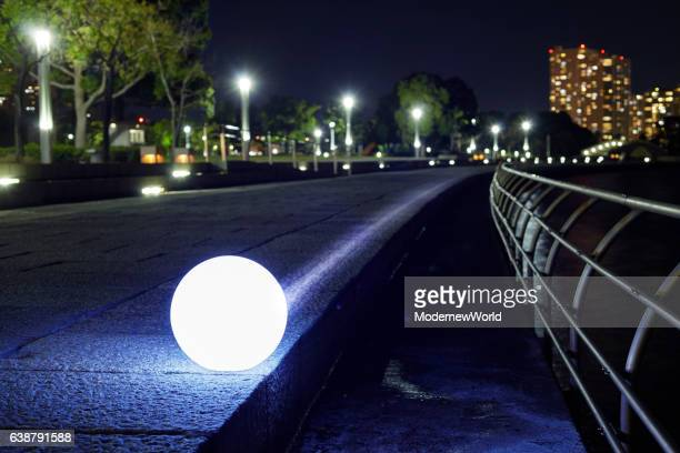 The Led ball moving on the waterfront