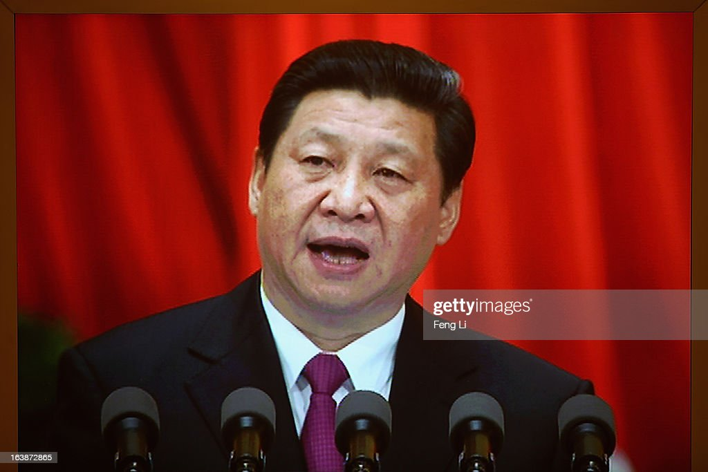 The LED screen shows newly-elected Chinese President <a gi-track='captionPersonalityLinkClicked' href=/galleries/search?phrase=Xi+Jinping&family=editorial&specificpeople=2598986 ng-click='$event.stopPropagation()'>Xi Jinping</a> delivering his maiden speech at the closing session of the National People's Congress (NPC) at the Great Hall of the People on March 17, 2013 in Beijing, China. China's newly-elected president <a gi-track='captionPersonalityLinkClicked' href=/galleries/search?phrase=Xi+Jinping&family=editorial&specificpeople=2598986 ng-click='$event.stopPropagation()'>Xi Jinping</a> pledged Sunday to resolutely fight against corruption and other misconduct in all manifestations.