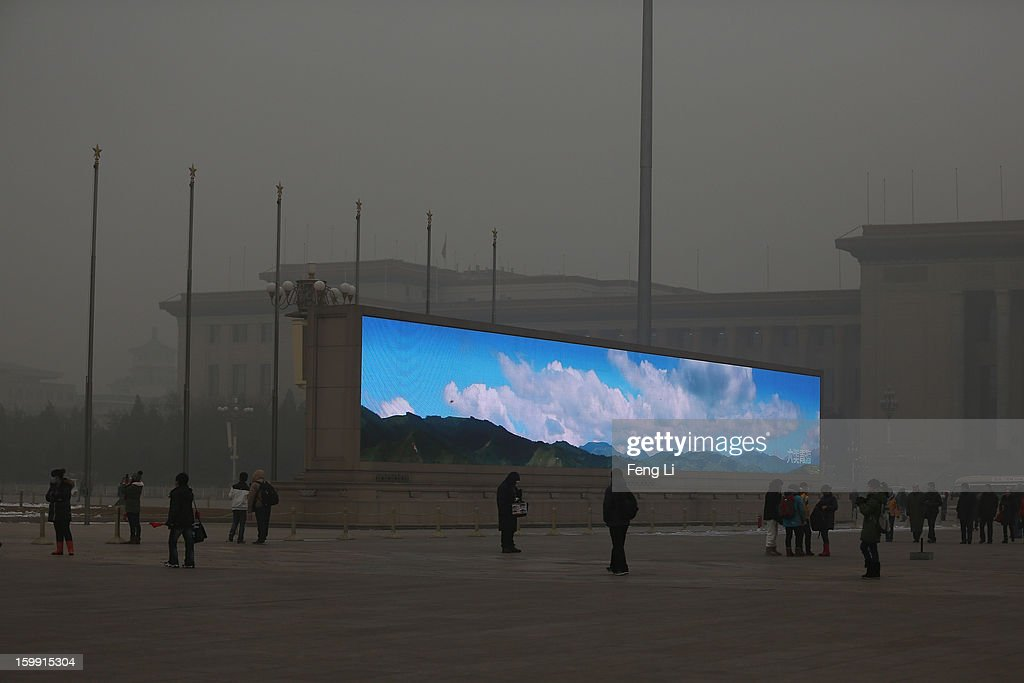 The LED screen shows the blue sky on the Tiananmen Square at dangerous levels of air pollution on January 23, 2013 in Beijing, China. The air quality in Beijing on Wednesday hit serious levels again, as smog blanketed the city.