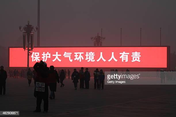 The LED screen shows the slogan 'protecting atmospheric environment is everyone's responsibility' on the Tiananmen Square which is shrouded with...