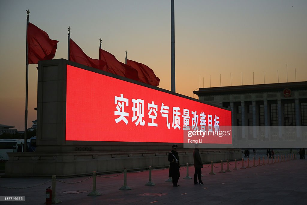 The LED screen shows the tagline 'achieve air quality improvement goals' at the Tiananmen Square outside the Great Hall of the People where the Communist Party's 205-member Central Committee gathered for its third annual plenum on November 12, 2013 in Beijing, China. The 18th Central Committee of the Communist Party of China (CPC) approved a decision on 'major issues concerning comprehensively deepening reforms' at the close of the Third Plenary Session of the 18th CPC Central Committee on Tuesday.