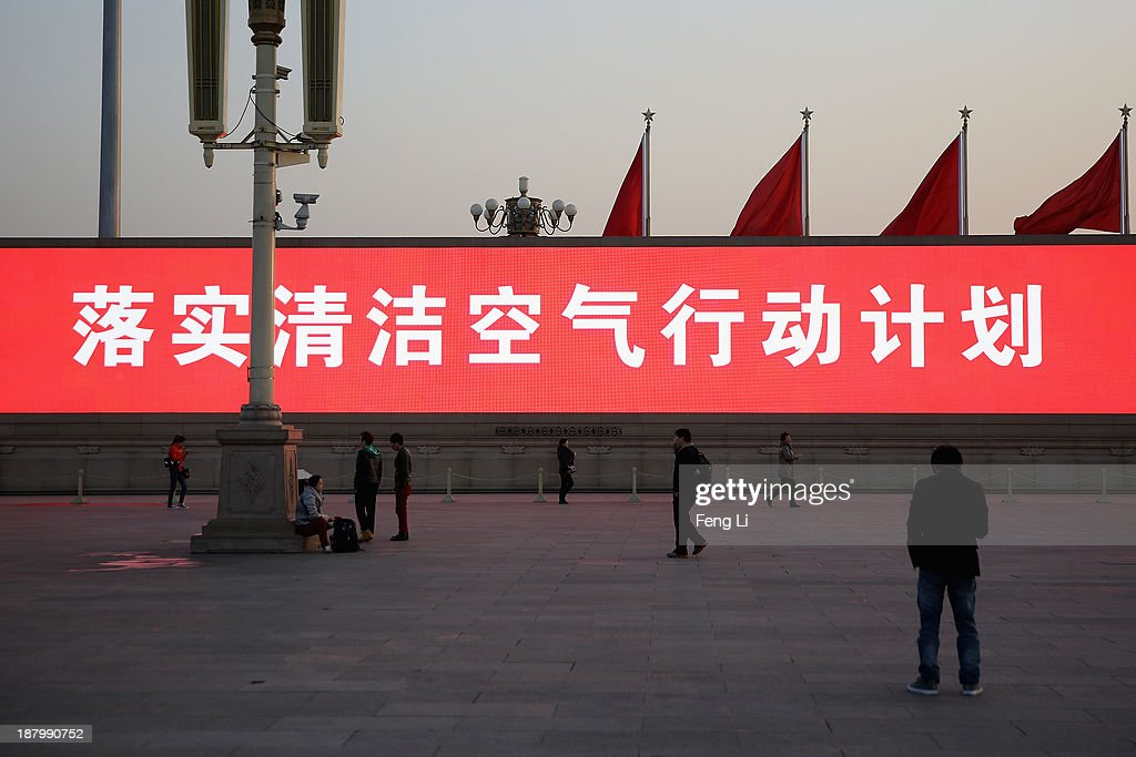 The LED screen shows the tagline 'achieve clean air plan' at the Tiananmen Square on November 14, 2013 in Beijing, China. The 18th Central Committee of the Communist Party of China (CPC) approved a decision on 'major issues concerning comprehensively deepening reforms' at the close of the Third Plenary Session of the 18th CPC Central Committee on Tuesday.