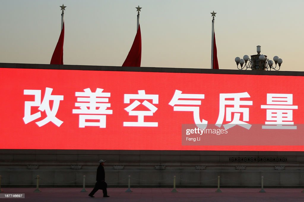 The LED screen shows the tagline 'improving air quality is everyone's responsibility' at the Tiananmen Square outside the Great Hall of the People where the Communist Party's 205-member Central Committee gathered for its third annual plenum on November 12, 2013 in Beijing, China. The 18th Central Committee of the Communist Party of China (CPC) approved a decision on 'major issues concerning comprehensively deepening reforms' at the close of the Third Plenary Session of the 18th CPC Central Committee on Tuesday.