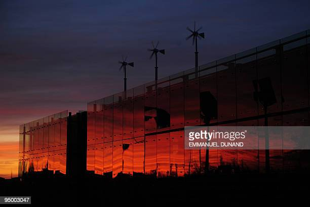 The LEEDplatinum certified '547 Art Center' and its wind turbines stands at sunset December 1 in Greensburg Kansas On May 4 Greensburg a typical...