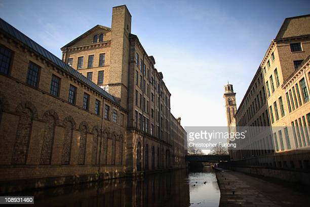 The Leeds Liverpool Canal runs alongside the Saltaire Village World Heritage Site in Bradford West Yorkshire on February 8 2011 in Bradford England...