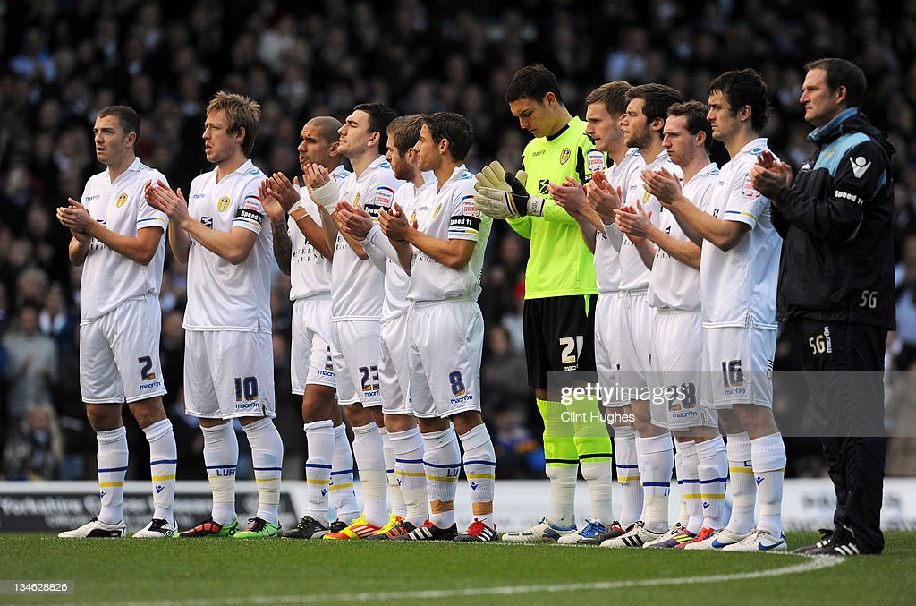 The Leeds United team lead a minutes applause in tribute to the late Gary Speed prior to kick off during the npower Championship match between Leeds United and Millwall at Elland Road on December 03, 2011 in Leeds, England.
