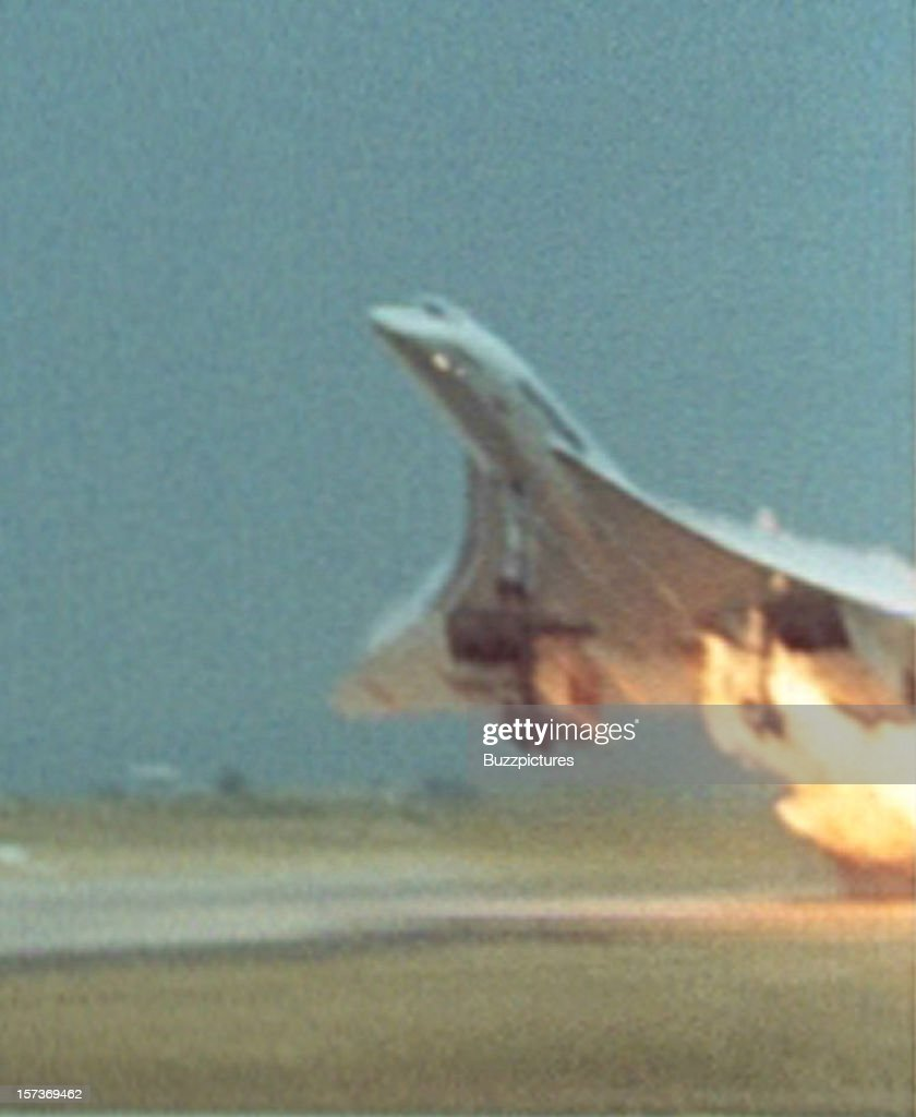 The left wing of supersonic passenger airliner Concorde, Air France Flight 4590, bursts into flame on take off from Paris Charles de Gaulle airport, Paris, en route for New York, 25th July 2000. Minutes later, the aircraft crashed in the suburb of Gonesse, killing all 100 passengers and nine crew members on board the flight, and four people on the ground. The crash is thought to have been caused by a small piece of metal on the runway puncturing a tyre.
