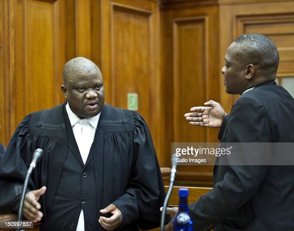 The legal team of coaccused Xolile Mngeni talk during the murder trial of Anni Dewani in the Cape Town High Court on August 30 2012 in Cape Town...