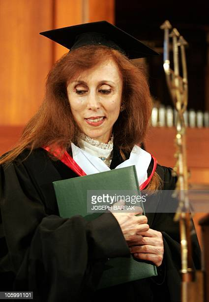 The legendary Lebanese singer Fairuz holds her diploma after she received a Honorary Doctorate at American University of Beirut 25 June 2005 AFP...