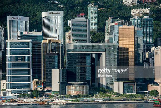 The Legislative Council building bottom center and the Central Government Offices middle center stand among other commercial and residential...