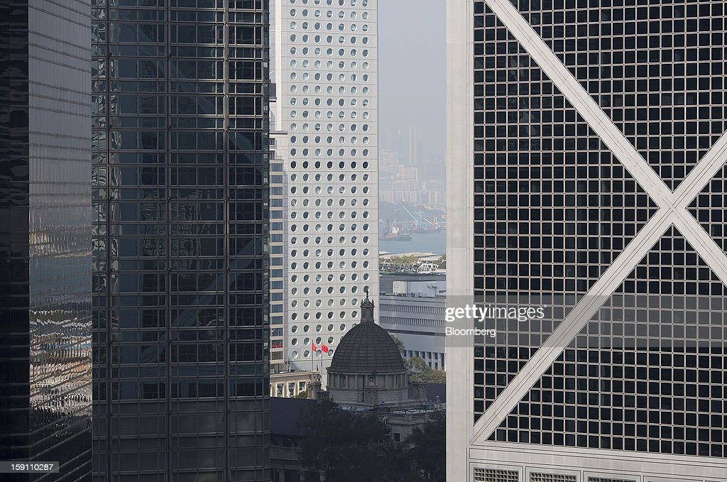 The Legislative Council Building, center, stands among office buildings in the central business district of Hong Kong, China, on Saturday, Jan. 5, 2013. Hong Kong topped the ranks as the most expensive office market by total occupancy cost, according to a report by CBRE Research released on Jan. 7. Photographer: Jerome Favre/Bloomberg via Getty Images