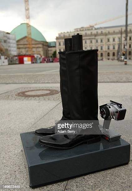 The legs and remote control of a trash canshaped robotic butler named Reiner which belongs to the Berliner Stadtreinigungsbetriebe city garbage...