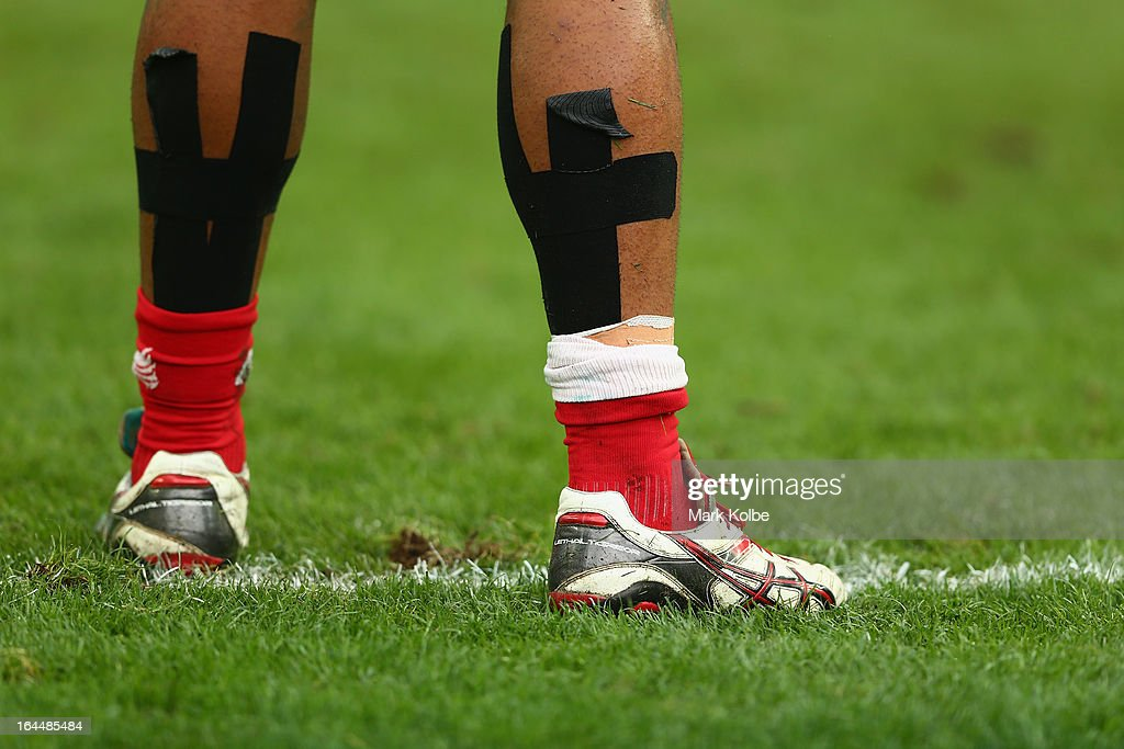 The legs of Michael Toloke of Tonga are seen during the qualifier quarter final match between Tonga and Tunisia on day three of the 2013 Hong Kong Sevens at Hong Kong Stadium on March 24, 2013 in So Kon Po, Hong Kong.