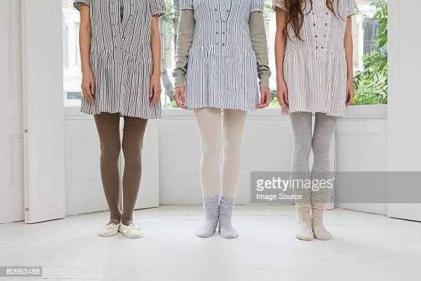 The legs of three women