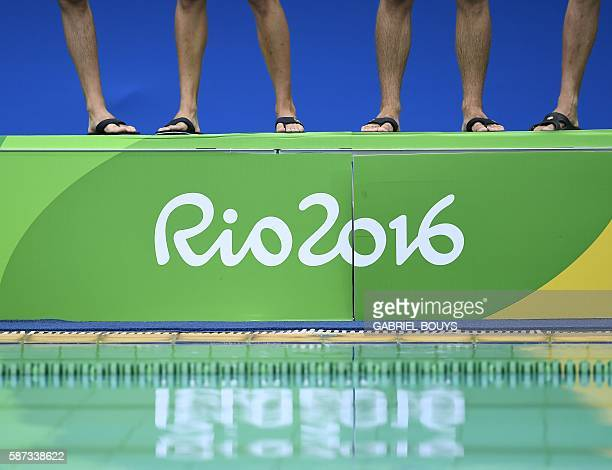 The legs of waterpolo players are seen above a Rio 2016 logo during the Italy vs France Rio 2016 Olympic Games waterpolo game on august 8 2016 in Rio...