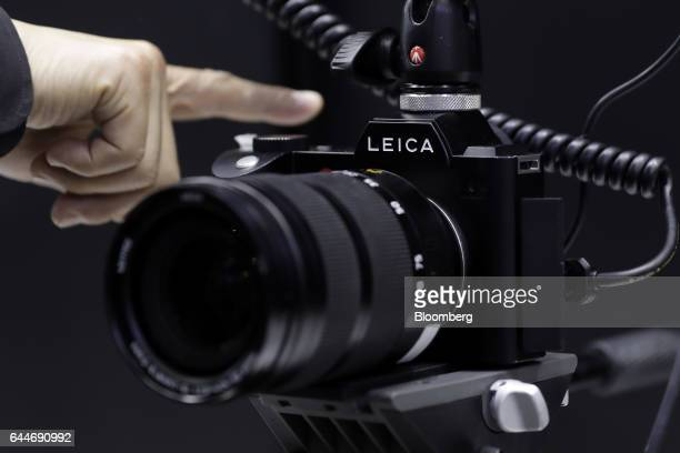The Leica SL fullframe mirrorless digital camera manufactured by Leica Camera AG attached with an Atomos Global Pty Ltd Ninja Flame recording monitor...
