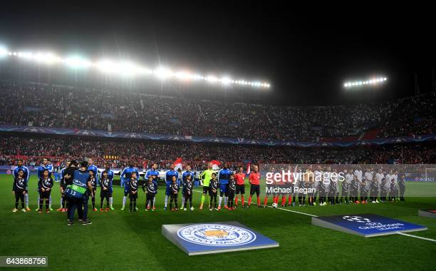 The Leicester City and Sevilla players line up before the UEFA Champions League Round of 16 first leg match between Sevilla FC and Leicester City at...