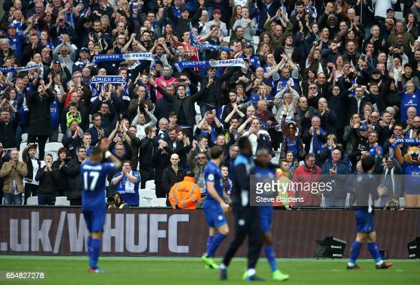 The Leicester City fans shows appreciation to the Leicester City players after the Premier League match between West Ham United and Leicester City at...