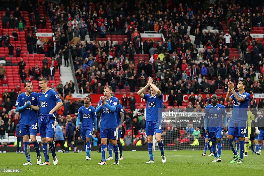 The Leicester City players applaud the travelling fans at the end of the Barclays Premier League match between Manchester United and Leicester City at Old Trafford on May 1, 2016 in Manchester, United Kingdom.