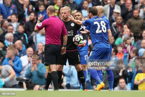 The Leicester City players protest to Referee Robert Madley after Manchester City scored the first goal during the Premier League match between...