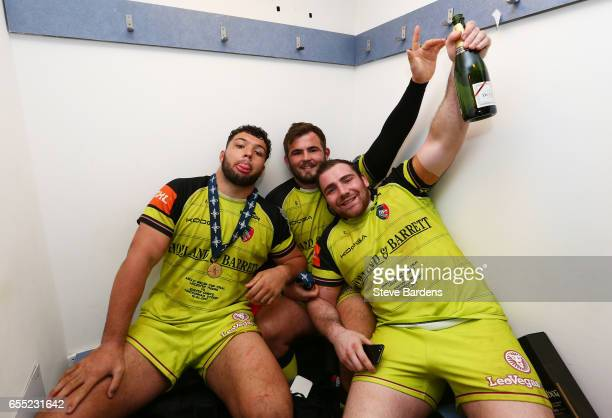 The Leicester front row of Ellis Genge George McGuigan and Fraser Balmain celebrate with the trophy following their team's 1612 victory during the...