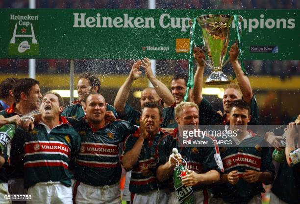 The Leicester Tigers crack open the champagne after beating Munster as the team celebrate with the trophy