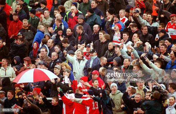 The Leigh Centurions fans celebrate a try