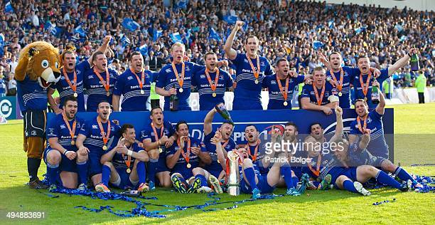 The Leinster team celebrate after defeating Glasgow to win the RaboDirect Pro 12 trophy during the RaboDirect Pro 12 match between Leinster and...