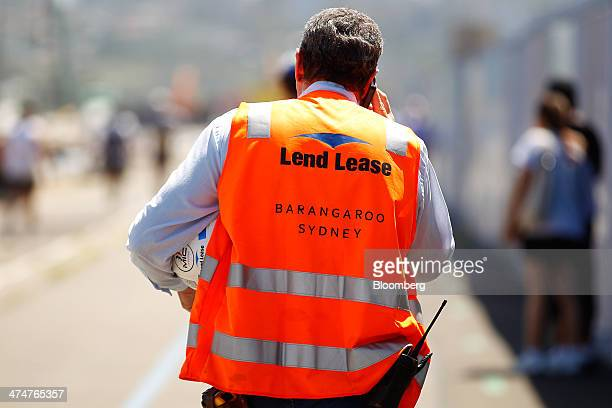 The Lend Lease Group logo is displayed on an employee's safety vest outside the site of the company's Barangaroo South redevelopment in Sydney...