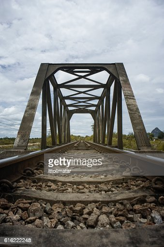 the length of railway with old steel bridge : Stock-Foto
