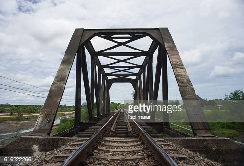 the length of railway with old steel bridge : ストックフォト