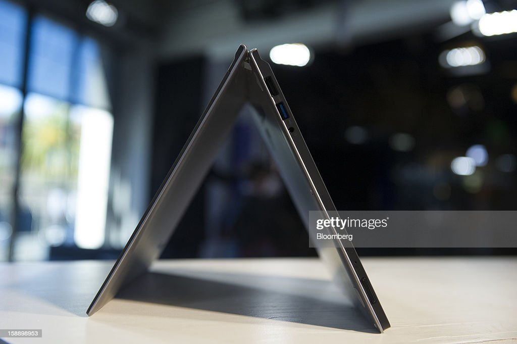 The Lenovo Group Ltd. IdeaPad Yoga is arranged for a photograph in San Francisco, California, U.S., on Thursday, Dec. 27, 2012. Lenovo's IdeaPad Yoga runs on Microsoft Corp.'s Windows 8 operating system. Photographer: David Paul Morris/Bloomberg via Getty Images