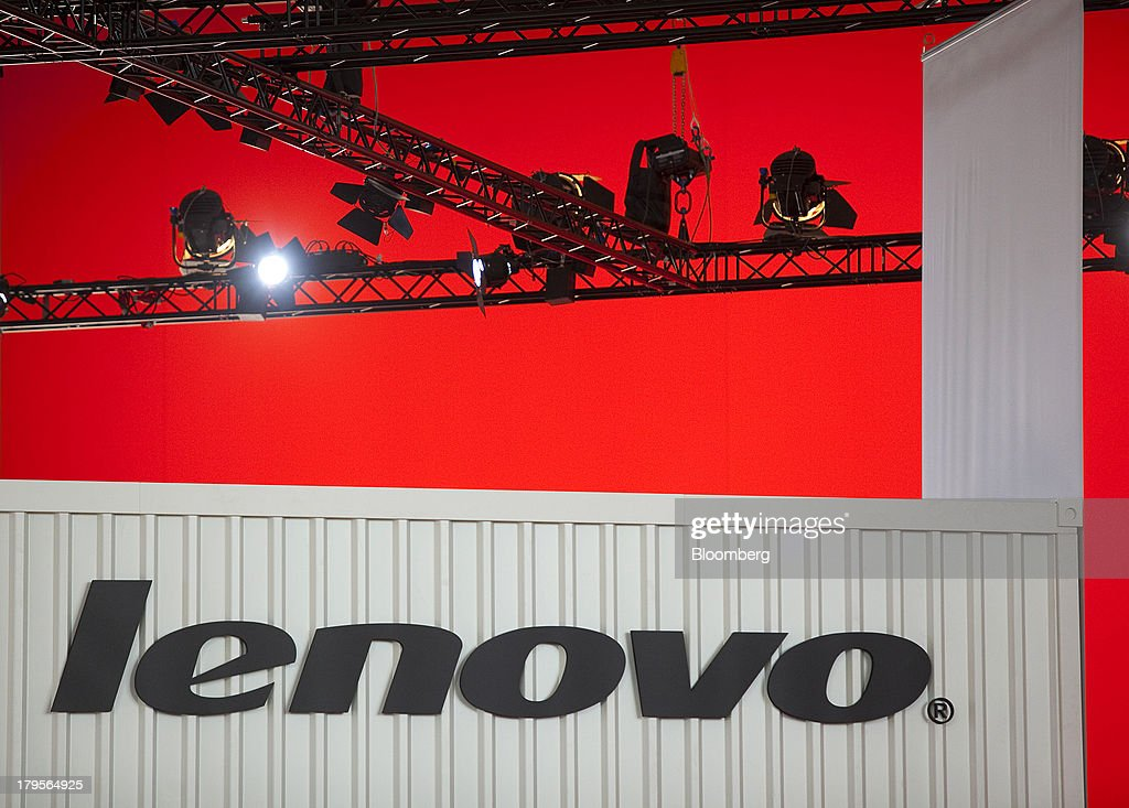The Lenovo Group Ltd logo sits on display beneath a lighting rig on the eve of the opening of the IFA consumer electronics show in Berlin, Germany, on Thursday, Sept. 5, 2013. Samsung showed the Galaxy Gear yesterday at IFA, Europe's largest consumer-electronics show, as it races Apple and Sony Corp. to carve a share of the market for wearable technology amid slowing growth in smartphones. Photographer: Krisztian Bocsi/Bloomberg via Getty Images
