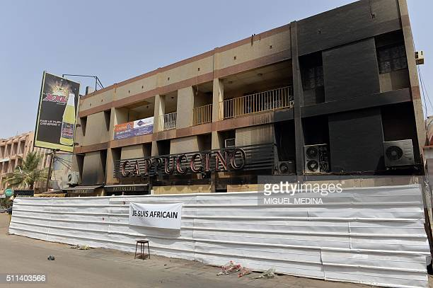 The lettering on a banner attached to a fence reads 'I am African' in front of the Cappuccino cafe in Ouagadougou on February 20 more than a month...