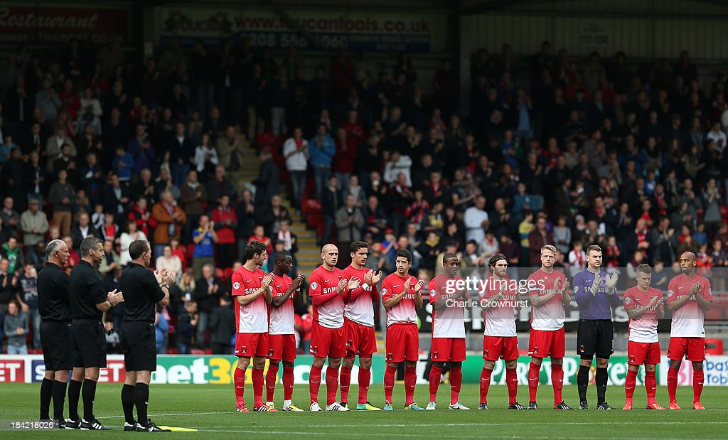 The Leyton Orient team hold a minutes applause for Laurie Cunningham during the Sky Bet League One match between Leyton Orient and MK Dons at The Matchroom Stadium on October 12, 2013 in London, England.