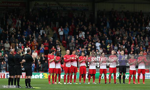 The Leyton Orient team hold a minutes applause for Laurie Cunningham during the Sky Bet League One match between Leyton Orient and MK Dons at The...
