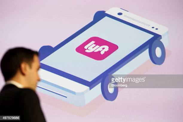 The Lfyt Inc logo is seen as John Zimmer cofounder and president of Lyft Inc speaks during the Connected Car Expo ahead of the Los Angeles Auto Show...